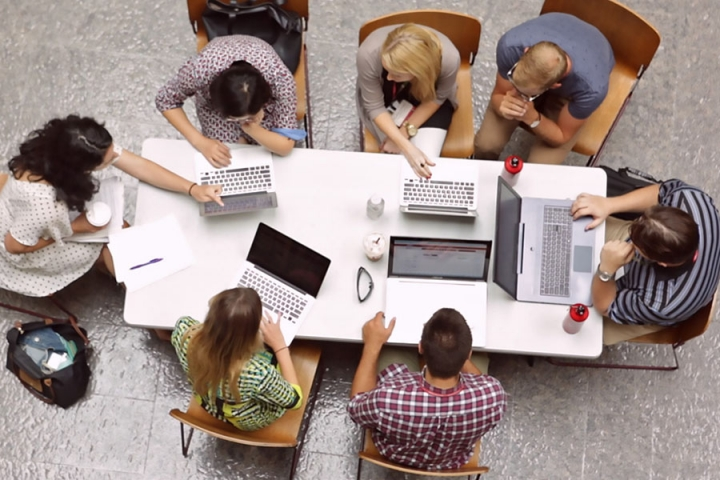 Overhead view of a group of student working together at a table