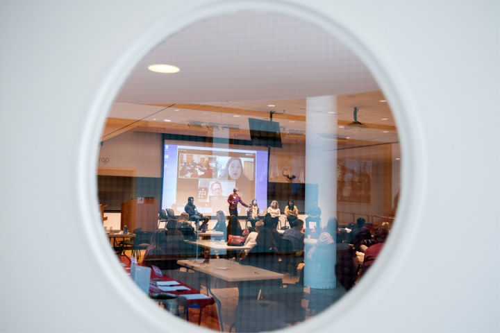The Cornell Online Learning Community Annual Event through the round window of the room door