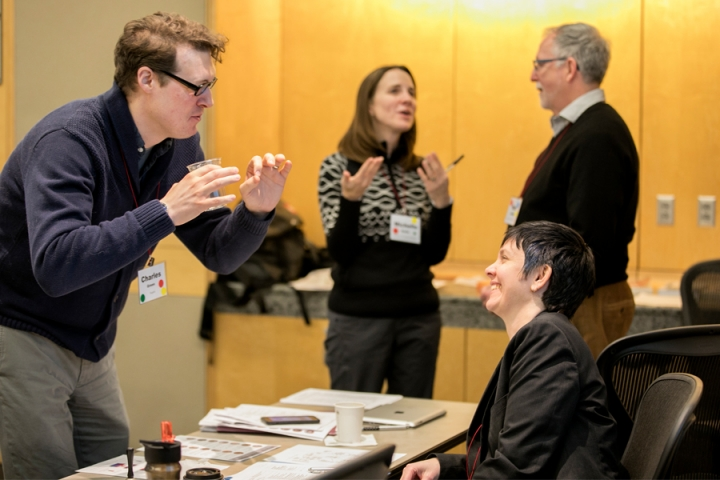 Four people talking during a professional development workshop