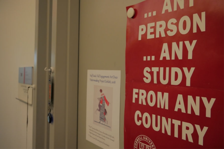 "Sign reading ""Any person any study from any country"" on an office door"
